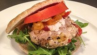CHICKEN BURGER TOPPED WITH FETA, ROASTED RED BELL PEPPER & ARUGULA