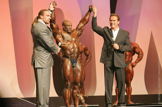 ARNOLD AT THE 2004 MR. OLYMPIA CONTEST WITH RONNIE COLEMAN.