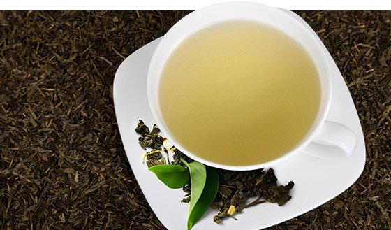 Caffeine in green tea may prevent adenosine's inhibition of dopaminergic transmission. Thus allowing for more dopamine, which plays a role in the clinical symptoms of Parkinson's disease.