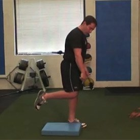 Single-leg squat with knee tap