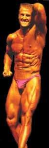 Mark Tilden, front, flexing