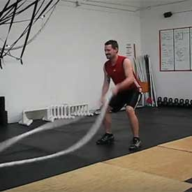 Single-arm front wave with jump squat (left)