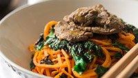 ORANGE BEEF STIR-FRY SWEET POTATO NOODLES AND KALE