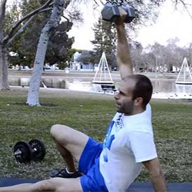 Dumbbell get-up sit-up