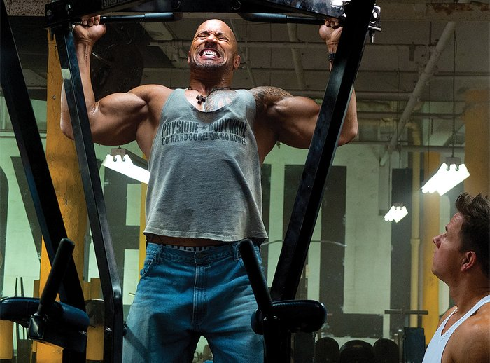 The rock working out in the gym