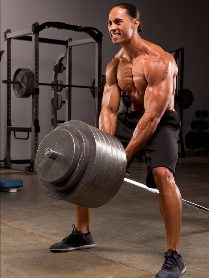 Muscular dudes balls pulled with weights