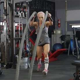 Split-squat jump with rope slam