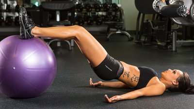 6 Legit Ways To Get Stronger With An Exercise Ball