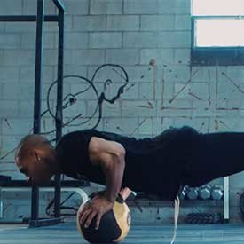 Feet-elevated medicine-ball push-up