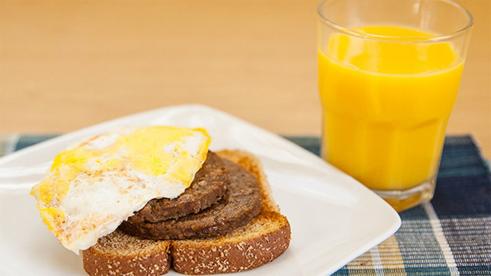 Sausage and Egg Sandwich with OJ