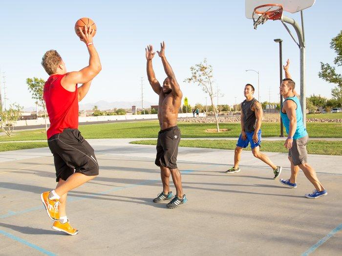 Playing basketball outdoors