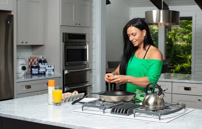Ashley Horner makes breakfast at her home.