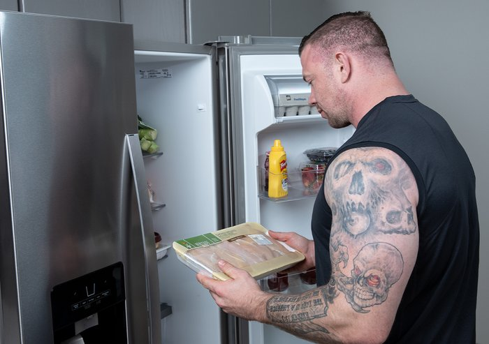 Male athlete reading a food label