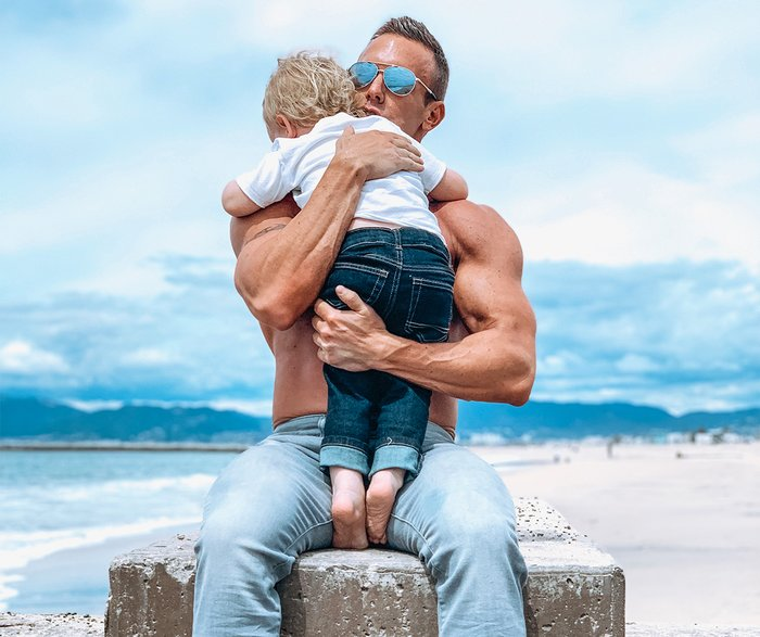 Brandan Fokken holds his son on the beach during a recent photo shoot.