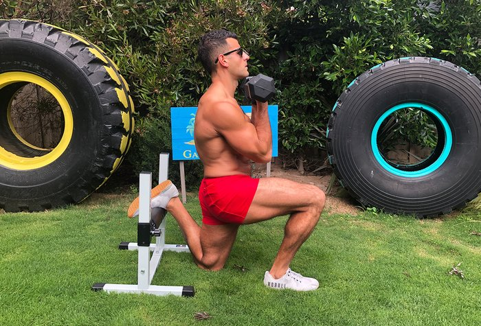All you need is a pair of dumbbells, or one heavy dumbbell held in the goblet position at shoulder level, and a single-leg squat stand.