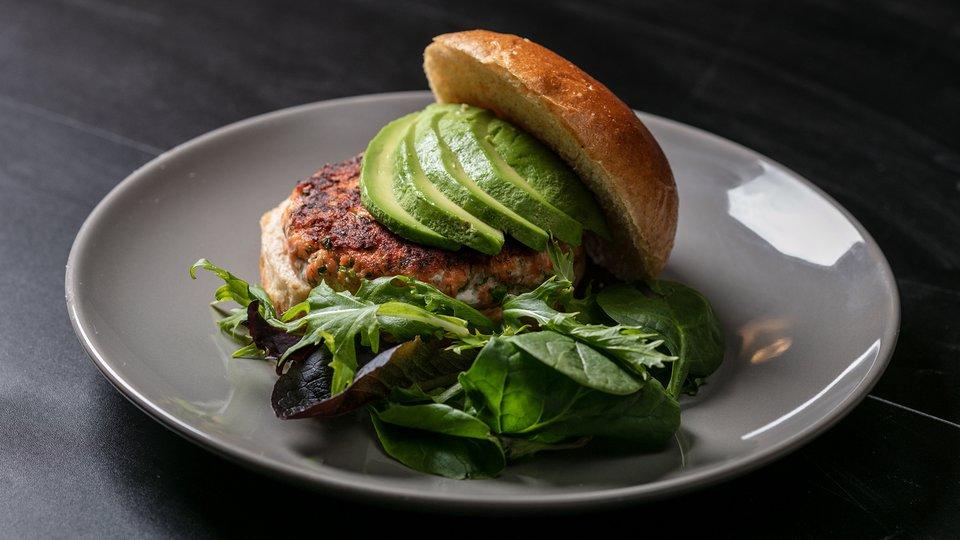 MetaBurn90: Salmon Burger with Avocado and Mixed Greens