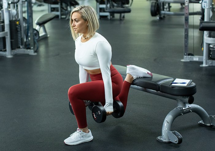 Dumbbell split squat with foot on bench.