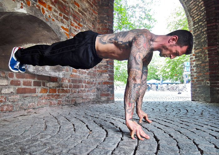 Danny Kavadlo performs a Feet-Elevated Push-up with Hands-Elevated Push-up