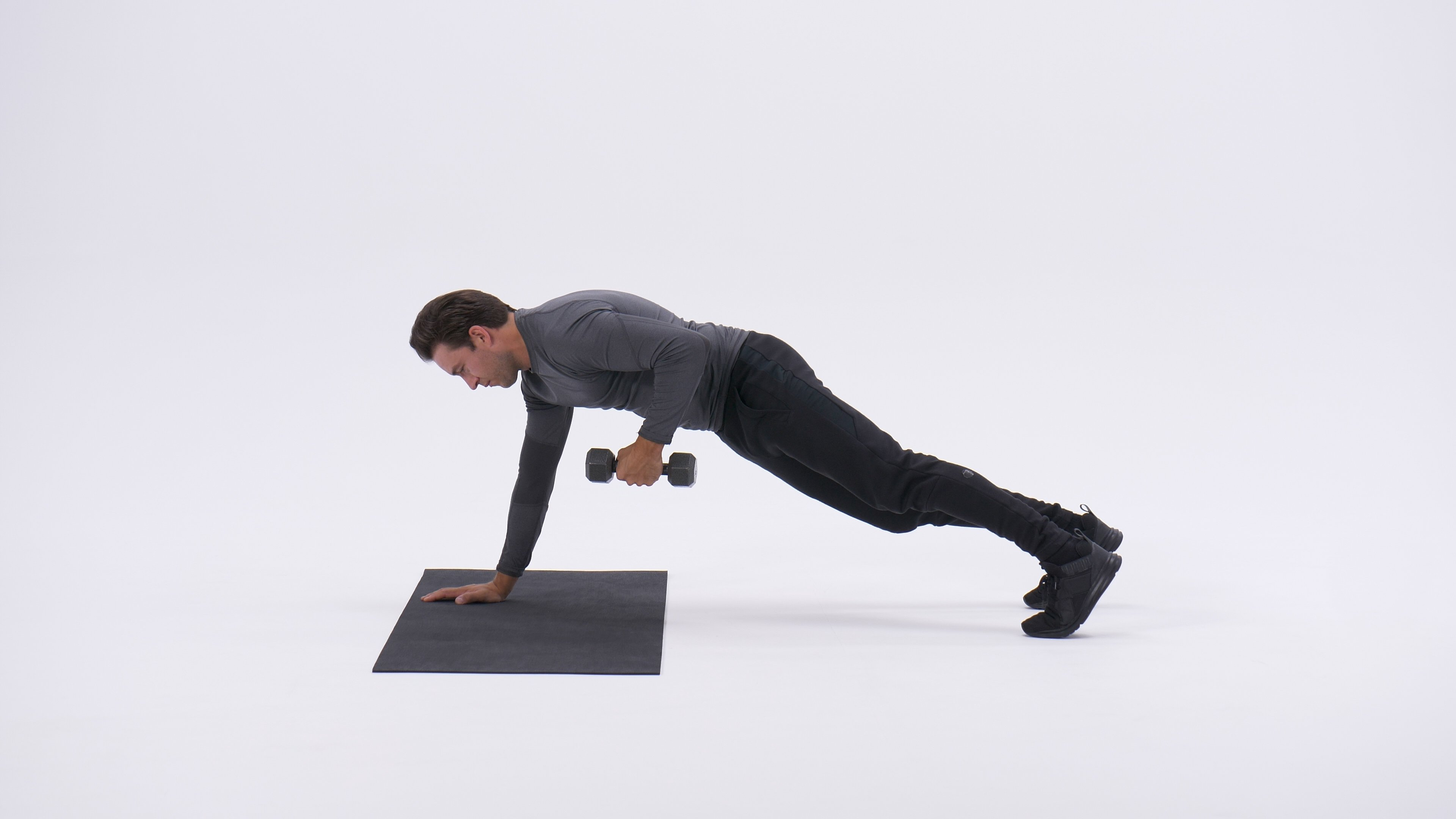 Straight-arm plank with kick-back image