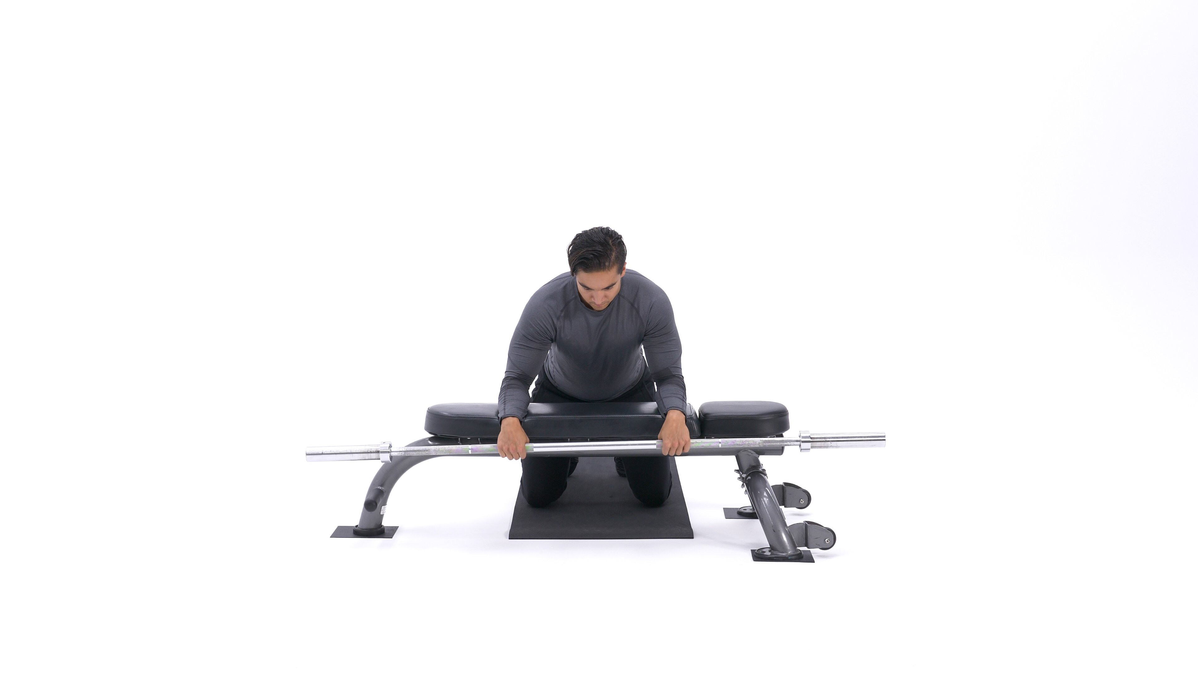 Palms-down wrist curl over bench image