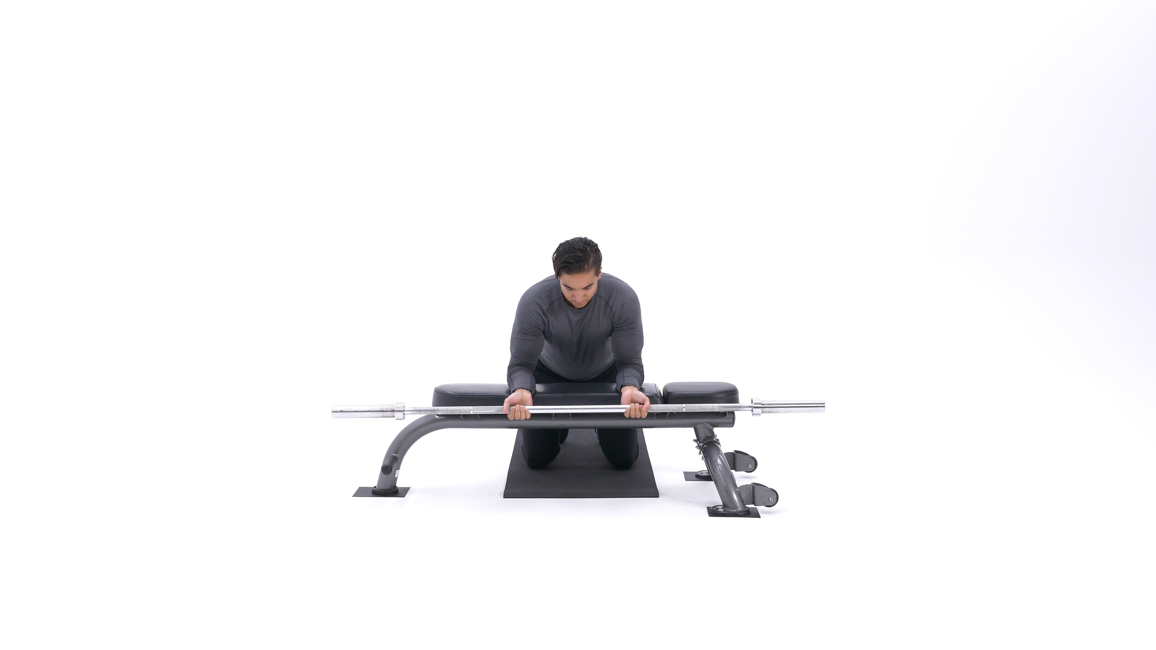 Palms-Up Barbell Wrist Curl Over A Bench image