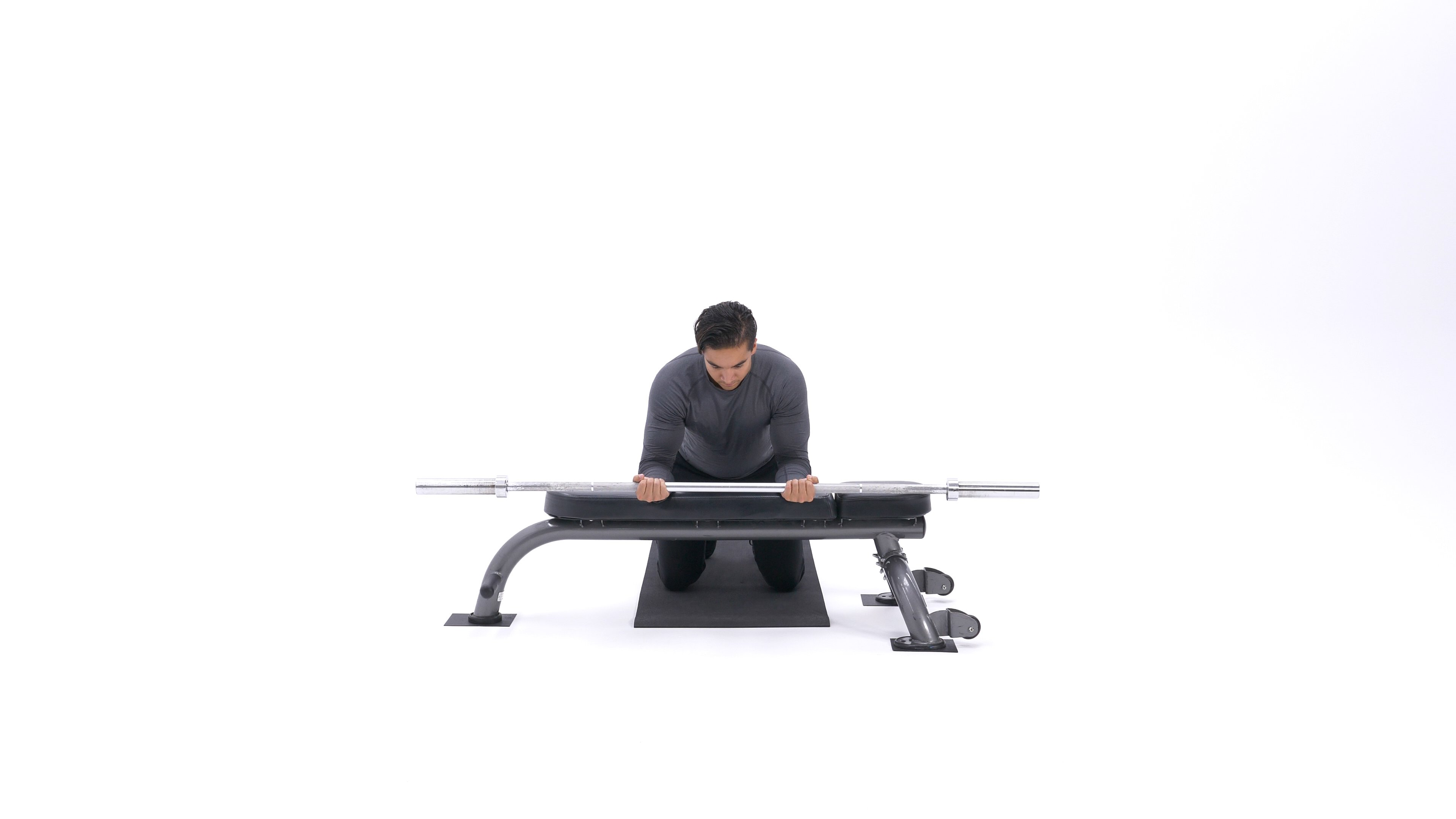 Palms-up wrist curl over bench image
