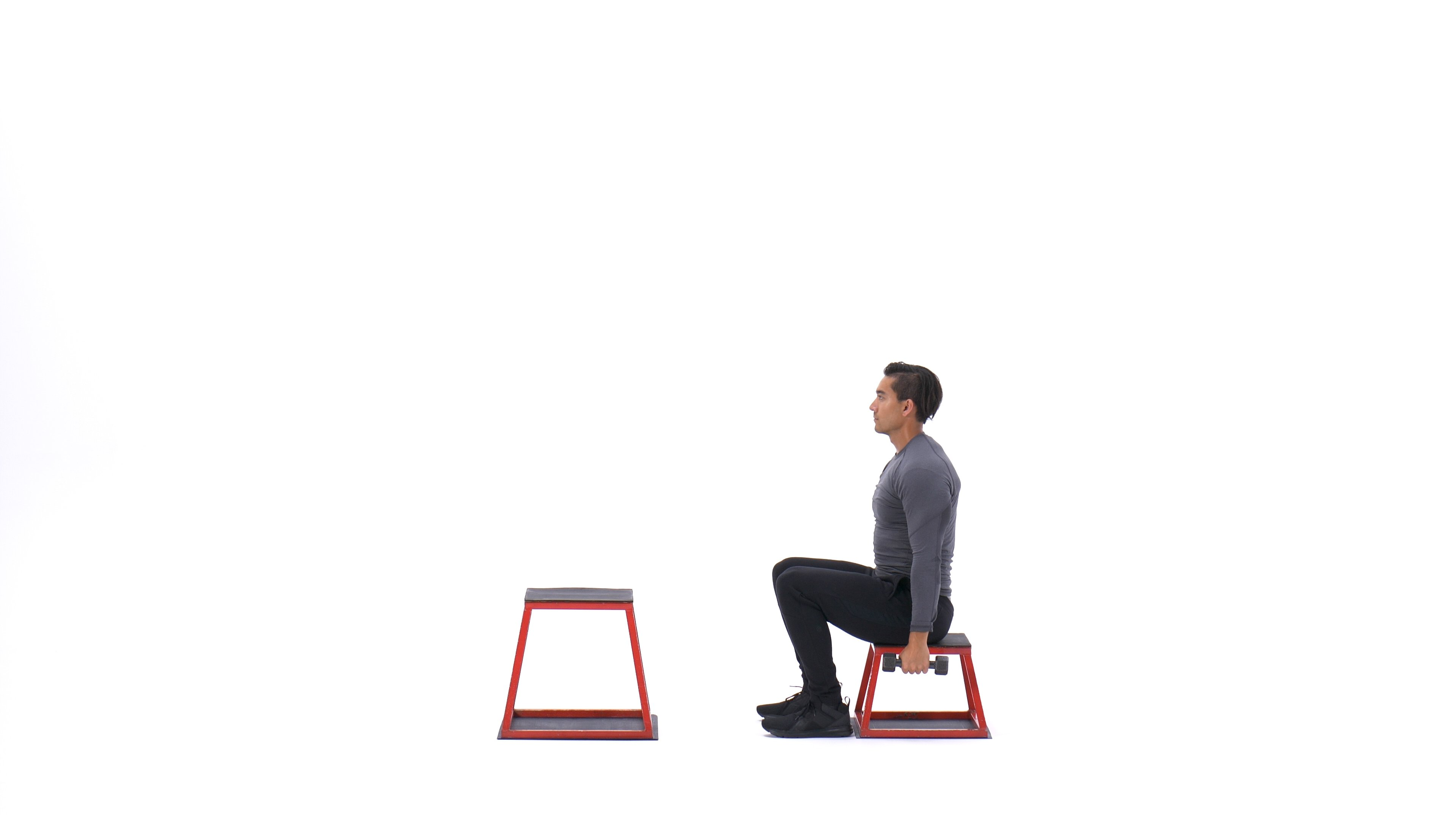 Dumbbell seated box jump image