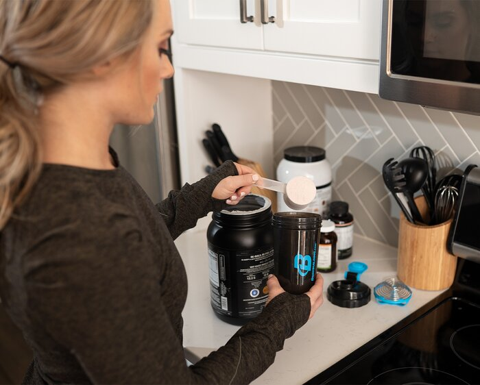 Mixing up a supplemental shake.