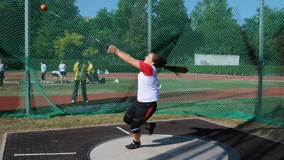 Olympic Hammer Throwers Spin Iron into Gold banner