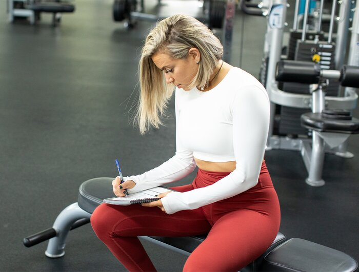 Writing down goals and PRs in a training journal