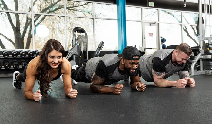 A group performing planks.