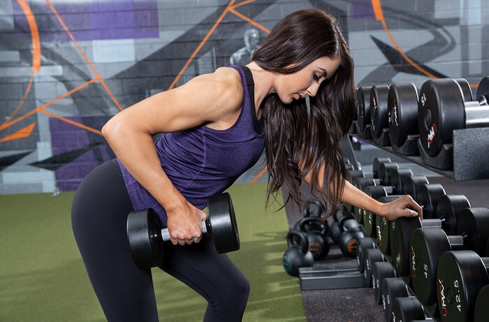 Female athlete performing a heavy dumbbell row.