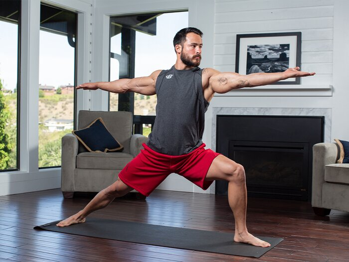 A male athlete performing yoga.