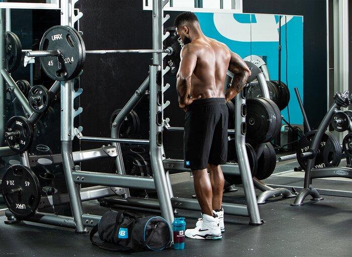 Preparing to squat.
