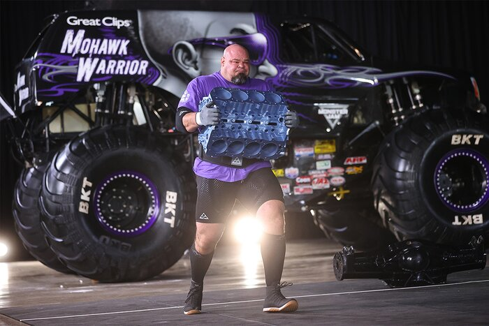 Brian Shaw carrying a heavy engine