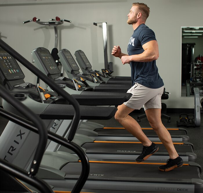 Running on a treadmill in the gym.