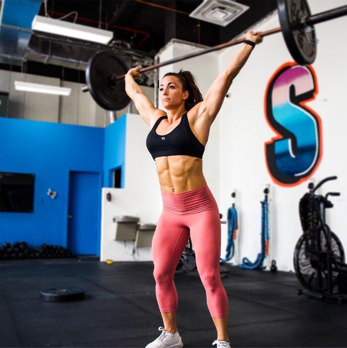 Lauren Sheehan performing an overhead lift