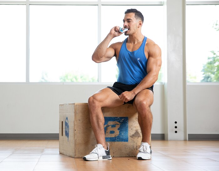Eating a protein bar in the gym