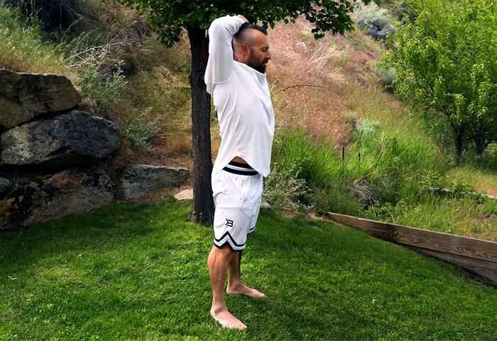 Kris Gethin performing the grounding technique