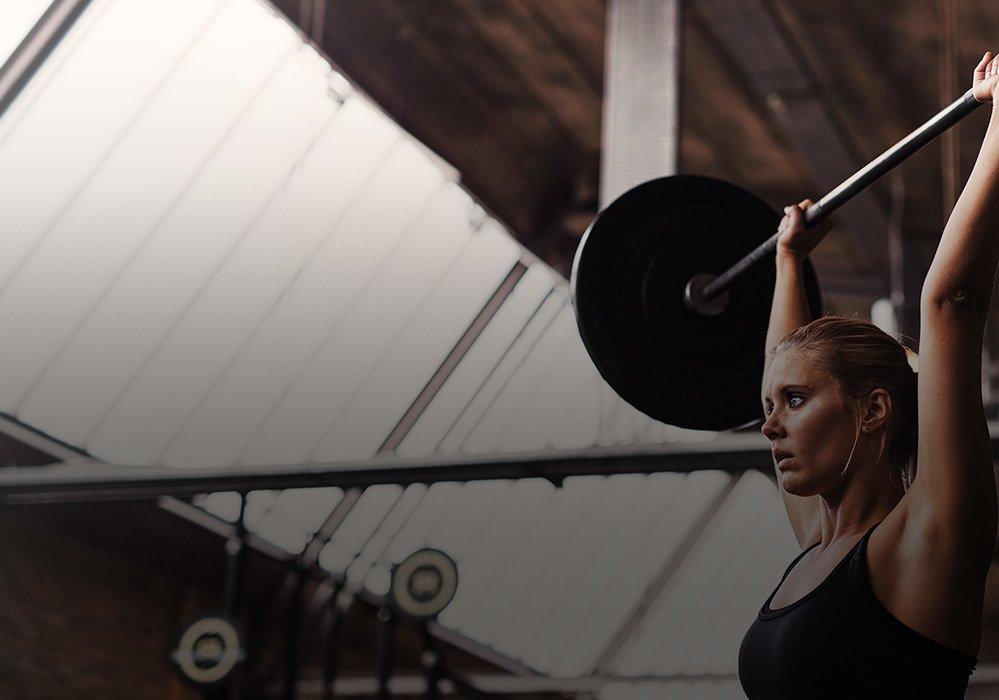 Revel Brand Header - Woman Lifting Weights