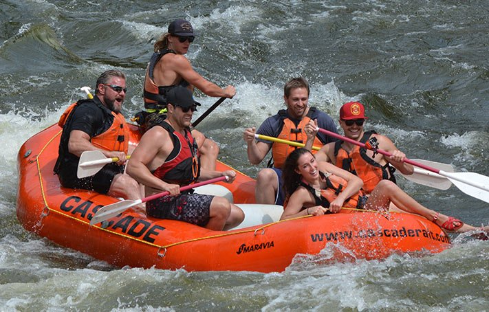 Lance ripping it up on the wild rapids of Idaho during a Marketing team building event.