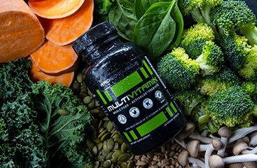 Kaged Multivitamins - shown next to vegetables