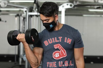 Bodybuilding.com Super Air Mask - bicep curl in the gym
