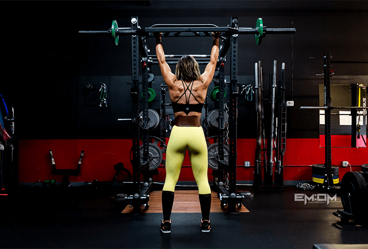 Female Athlete Shoulder Pressing