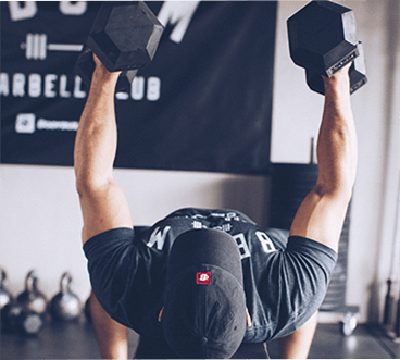 Dad Hat on Athlete performing Dumbbell Flyes