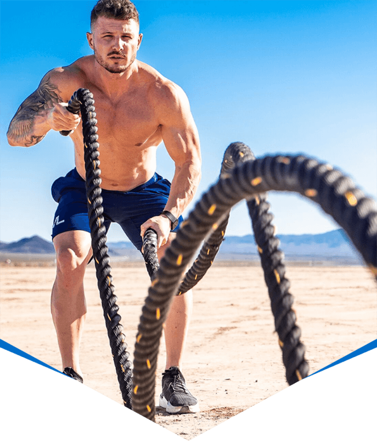 Athlete Exercising with Battle Ropes