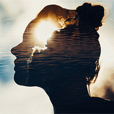 silhouette of a woman and the water