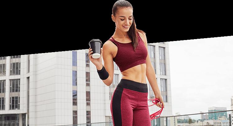 Female Athlete Holding Coffee