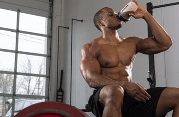 Athlete drinking Six Star Whey Isolate