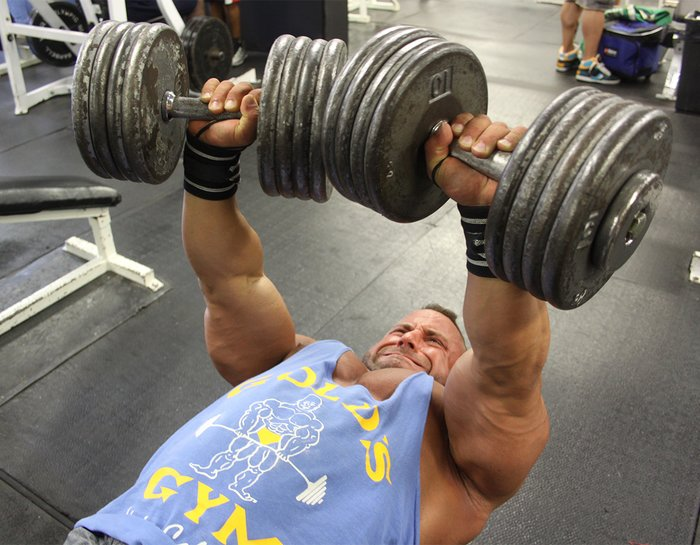 After pre-exhausting with lighter weights, [IFFB pro] Steve Silverman cranks our fewer but heavier dumbbell bench presses.